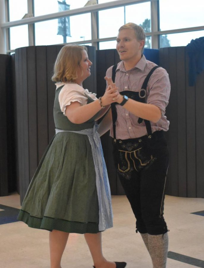 Herr Frie and his wife demonstrate a traditional Bavarian dance at the Oktoberfest celebration held on October 1.